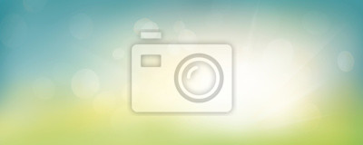Image A fresh spring blue sunny sky background with blurred warm sunny glow.