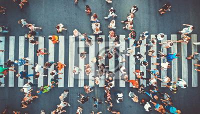Image Aerial. People crowd on pedestrian crosswalk. Top view background. Toned image.