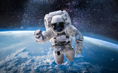 Image Astronaut in the outer space over the planet Earth. Abstract wallpaper. Spaceman. Elements of this image furnished by NASA