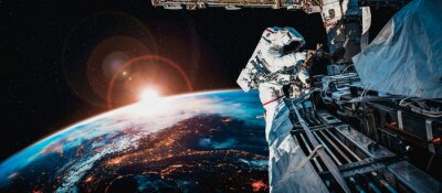 Image Astronaut spaceman do spacewalk while working for space station in outer space . Astronaut wear full spacesuit for space operation . Elements of this image furnished by NASA space astronaut photos.