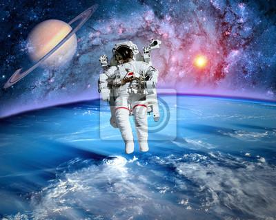 Astronaute cosmonaute espace planète extérieure de lunivers peintures  murales • tableaux belle, la science-fiction, satellite | myloview.fr