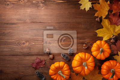Image Autumn Thanksgiving background. Pumpkins, acorns and leaves on rustic table top view.