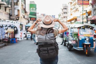 Image Back view Asian woman tourist backpacker travel in Khao San road, Bangkok, Thailand