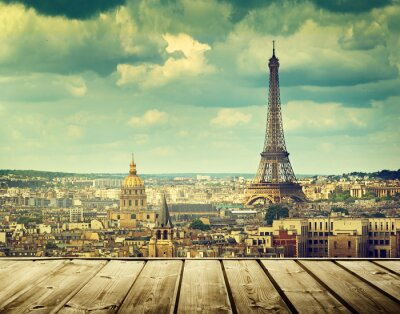 Image background with wooden deck table and Eiffel tower in Paris