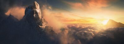 Image Beautiful aerial landscape of mountain peak at sunset above the clouds - panoramic