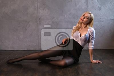 Image Beautiful blonde girl in pantyhose posing on the floor.