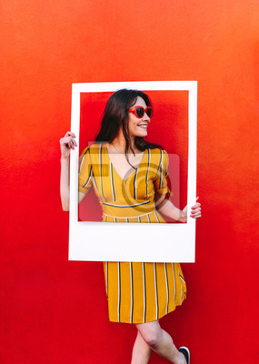 Image Beautiful woman posing with empty picture frame