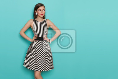 Image Beautiful Young Woman In Black And White Striped Dress Is Looking Away
