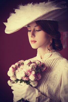 Image Belle rousse femme avec bouquet