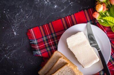 Beurre et pain. Concept de petit-déjeuner
