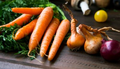 Bio organic vegetables with carrots , onions and garlic, fresh healthy bio veggies from garden