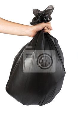 Black garbage bag in his hand