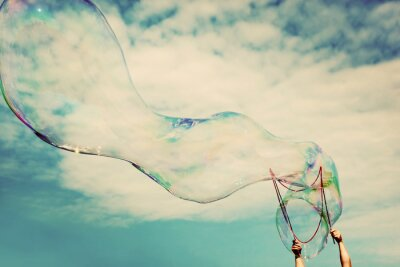 Image Blowing big soap bubbles in the air. Vintage freedom, summer concepts.