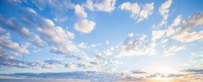 Image Blue sky clouds background. Beautiful landscape with clouds and orange sun on sky