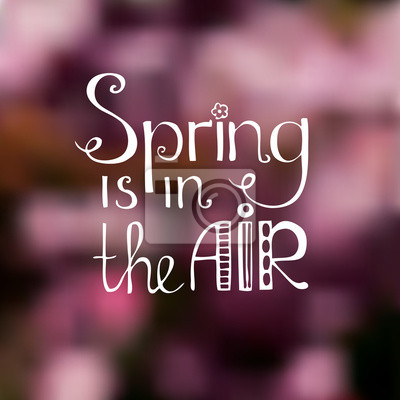 """Blurred background with the text """"Spring in the air"""""""