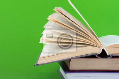 books on a green background