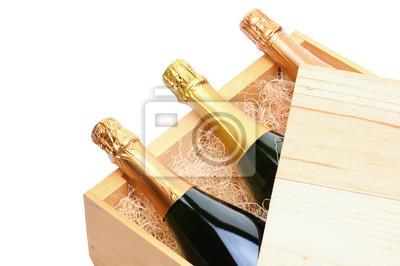 Bouteilles de champagne dans une caisse en bois