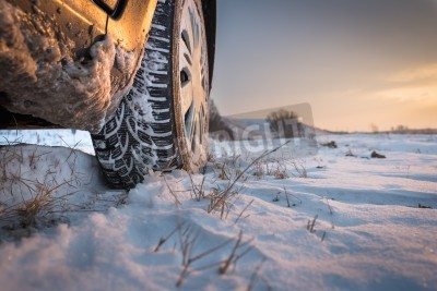 Image Car tires on winter road