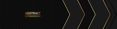 Image Carbon fiber black hexagon texture. Black and gold arrows on dark carbon mesh.