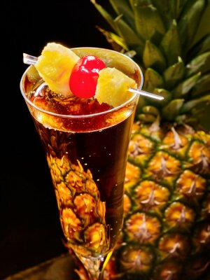 Champagne  cocktail with cherry and pineapple