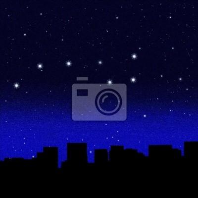 Ciel nocturne noir plein d'étoiles avec Great Bear sur une ville