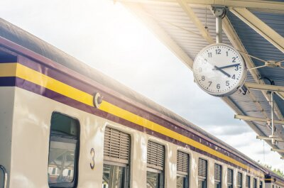 Image Classic urban analog clock in train station terminal. Concept photo of time, appointment, deadline, meeting, business, travel and schedule..