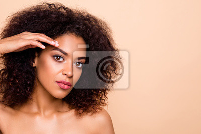Image Close up photo beautiful she her dark skin model lady wavy hairdo smearing cream forehead lotion pure perfect mask aesthetic ideal skin no wrinkles wear nothing nude isolated pastel beige background