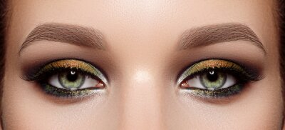 Image Closeup Macro of Woman Face with Green Eyes Make-up. Fashion Celebrate Makeup, Glowy Clean Skin, perfect Shapes of Brows