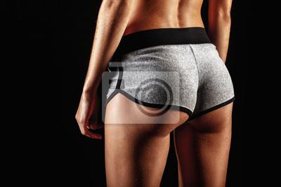 closeup woman buttocks over dark