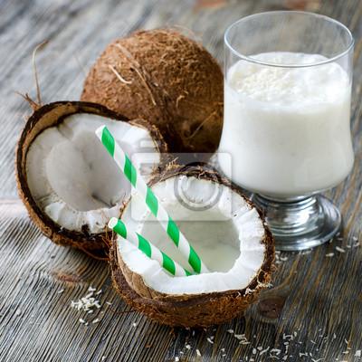 Coconut milk smoothie drink on wooden background