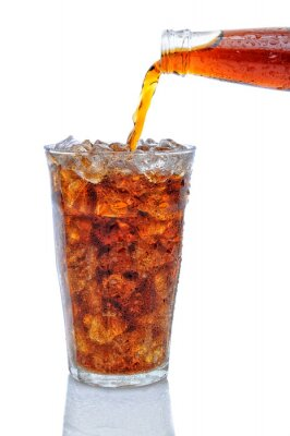 Cola Pouring from Bottle into Glass of Ice