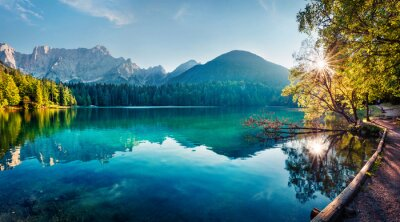 Image Colorful summer view of Fusine lake. Bright morning scene of Julian Alps with Mangart peak on background, Province of Udine, Italy, Europe. Traveling concept background.