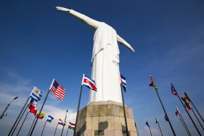 Image Cristo del Rey statue of Cali with world flags and blue sky, Col