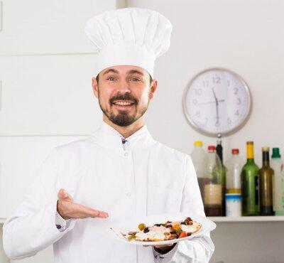 Image Male cook preparing food