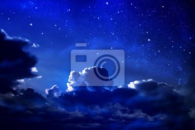 dark cloudy night sky with stars and nebula