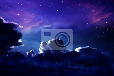 dark cloudy night sky with stars and nebulae
