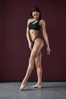 Image Demonstrating hot body. Pretty young woman posing in the room