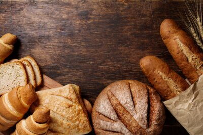Image Different bread on a rustic dark background
