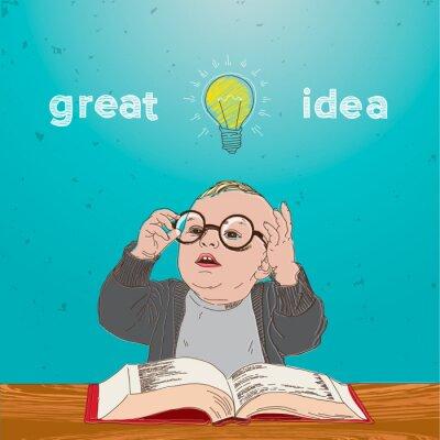 Image Excellente idée, enfant avec le livre et l'ampoule au-dessus de sa tête