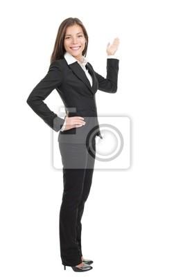 Femme d'affaires affichant l'espace de copie