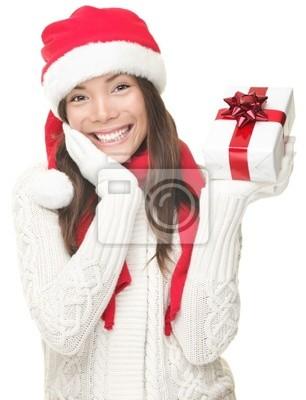 Femme de Santa montrant cadeau souriant - Noël