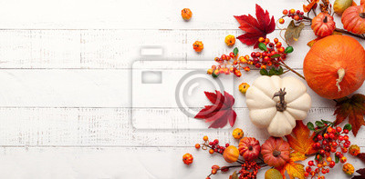 Image Festive autumn decor from pumpkins, berries and leaves on a white  wooden background. Concept of Thanksgiving day or Halloween. Flat lay autumn composition with copy space.