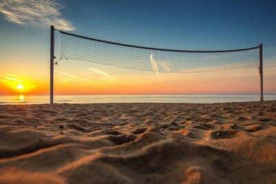 Image Filet de volley-ball et le lever du soleil sur la plage