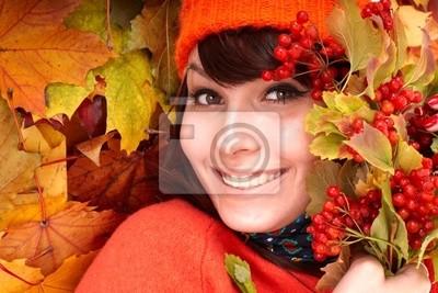 Fille au chapeau orange l'automne sur la feuille group.Outdoor.