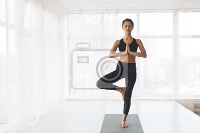 Image Finding right balance. Woman doing perfect tree pose