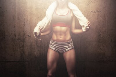 Image Fitness woman after hard workout training holding white sports towel