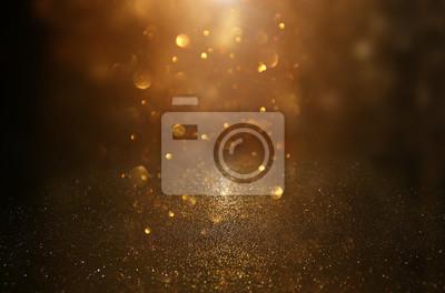 Image fond de lumières vintage de paillettes. noir et or. déconcentré.