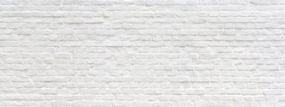 Image Fond panoramique mur de briques anciennes peintes en blanc