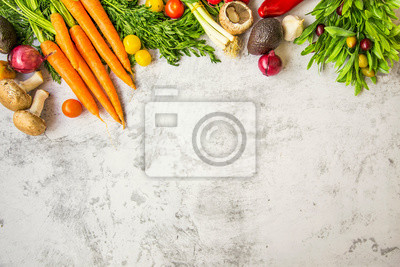 Fresh vegetables top view on concrete table with copy space