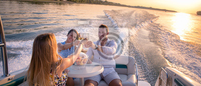 Image Friends are drinking on a boat in sunset